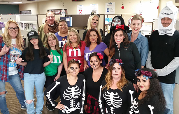 The group takes a snapshot of our annual Halloween parade.